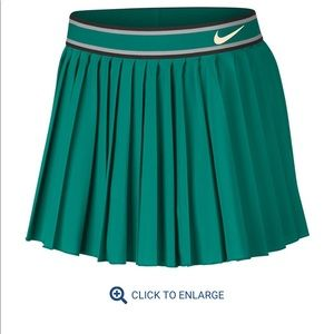 Nike green tennis skort, size M, worn only once